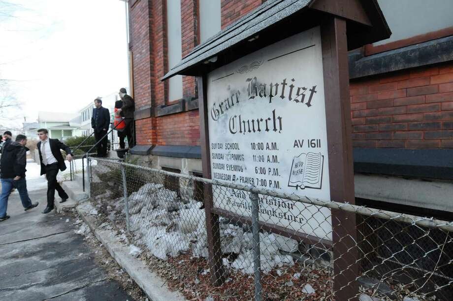 People arrive for service at  Grace Baptist Church on Sunday, March 23, 2014, in Troy, N.Y.  A drawing was held after service and a modified AR-15 rifle was given away.  (Paul Buckowski / Times Union) Photo: Paul Buckowski / 00026185A
