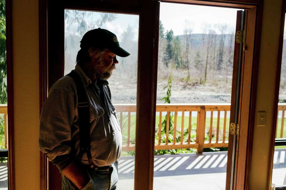 Twenty-three year Oso, Wash. resident Mark Headrick stands in the home he declined to evacuate on the banks of the Stillaguamish River Sunday, March 23, 2014, near Oso, Wash. Authorities say more than 18 people are unaccounted for after a massive mudslide killed at least four people and destroyed 30 homes, forcing evacuations from fears of the Stillaguamish River flooding. Photo: JORDAN STEAD, SEATTLEPI.COM / SEATTLEPI.COM