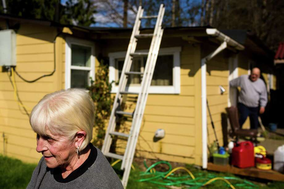 Oso, Wash. residents Freda Slack, left, and husband Pat, right, evacuated Saturday, but returned home after hearing of decreased flooding risk Sunday, March 23, 2014. Authorities say more than 18 people are unaccounted for after a massive mudslide killed at least four people and destroyed 30 homes, forcing evacuations from fears of the Stillaguamish River flooding. Photo: JORDAN STEAD, SEATTLEPI.COM / SEATTLEPI.COM