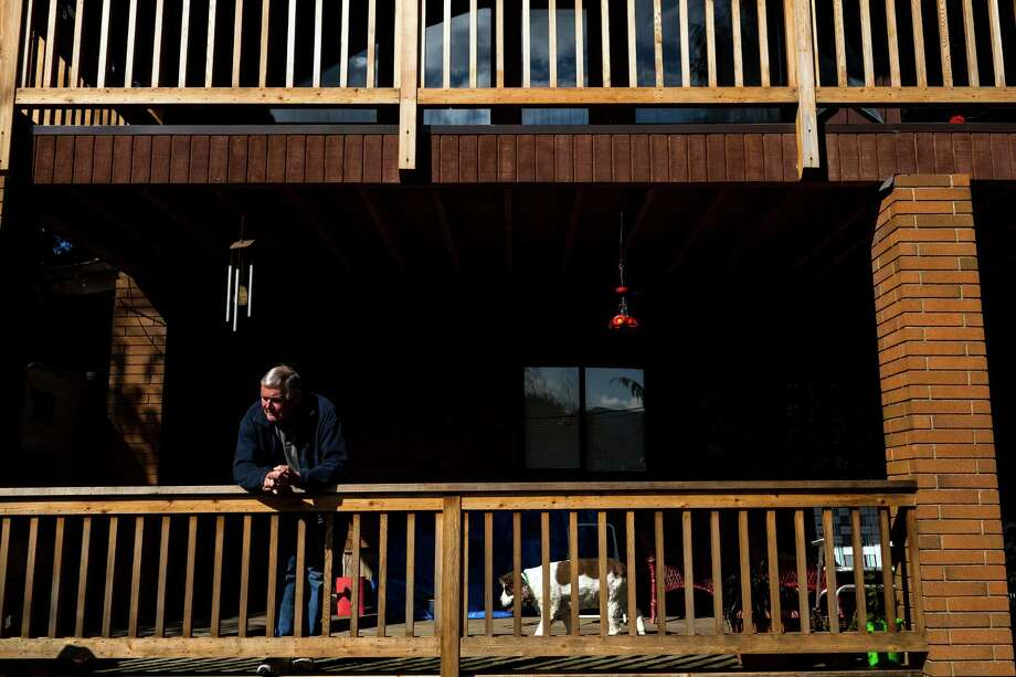 Oso, Wash. resident Bob Headrick, 79, declined to evacuate his home on the banks of the Stillaguamish River Sunday, March 23, 2014, near Oso, Wash. Authorities say more than 18 people are unaccounted for after a massive mudslide killed at least four people and destroyed 30 homes, forcing evacuations from fears of the Stillaguamish River flooding. Photo: JORDAN STEAD, SEATTLEPI.COM / SEATTLEPI.COM