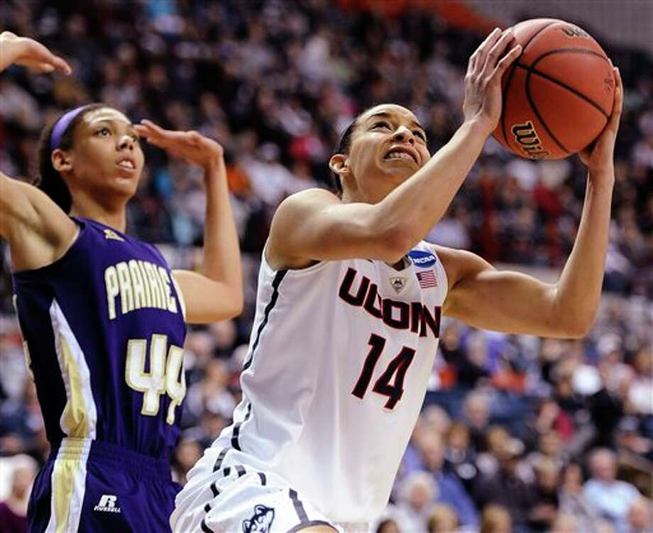 Connecticut's Bria Hartley,  right, shoots as Prairie View A&M's Asha Hampton-Finch, left,  defends during the first half of a first-round game of the NCAA women's  college basketball tournament, Sunday, March 23, 2014, in Storrs, Conn.  (AP Photo/Jessica Hill)