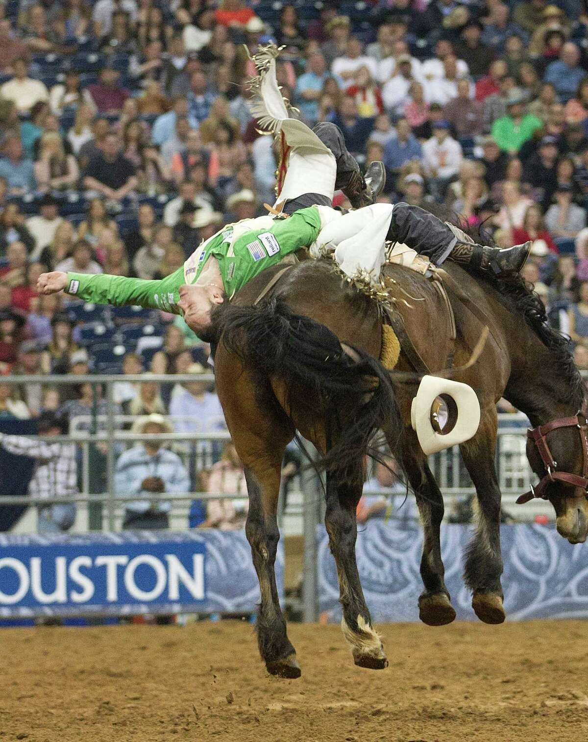 Clint Cannon hangs on during the RodeoHouston Super Shootout Bareback Riding event at Reliant Stadium Sunday, March 23, 2014, in Houston.