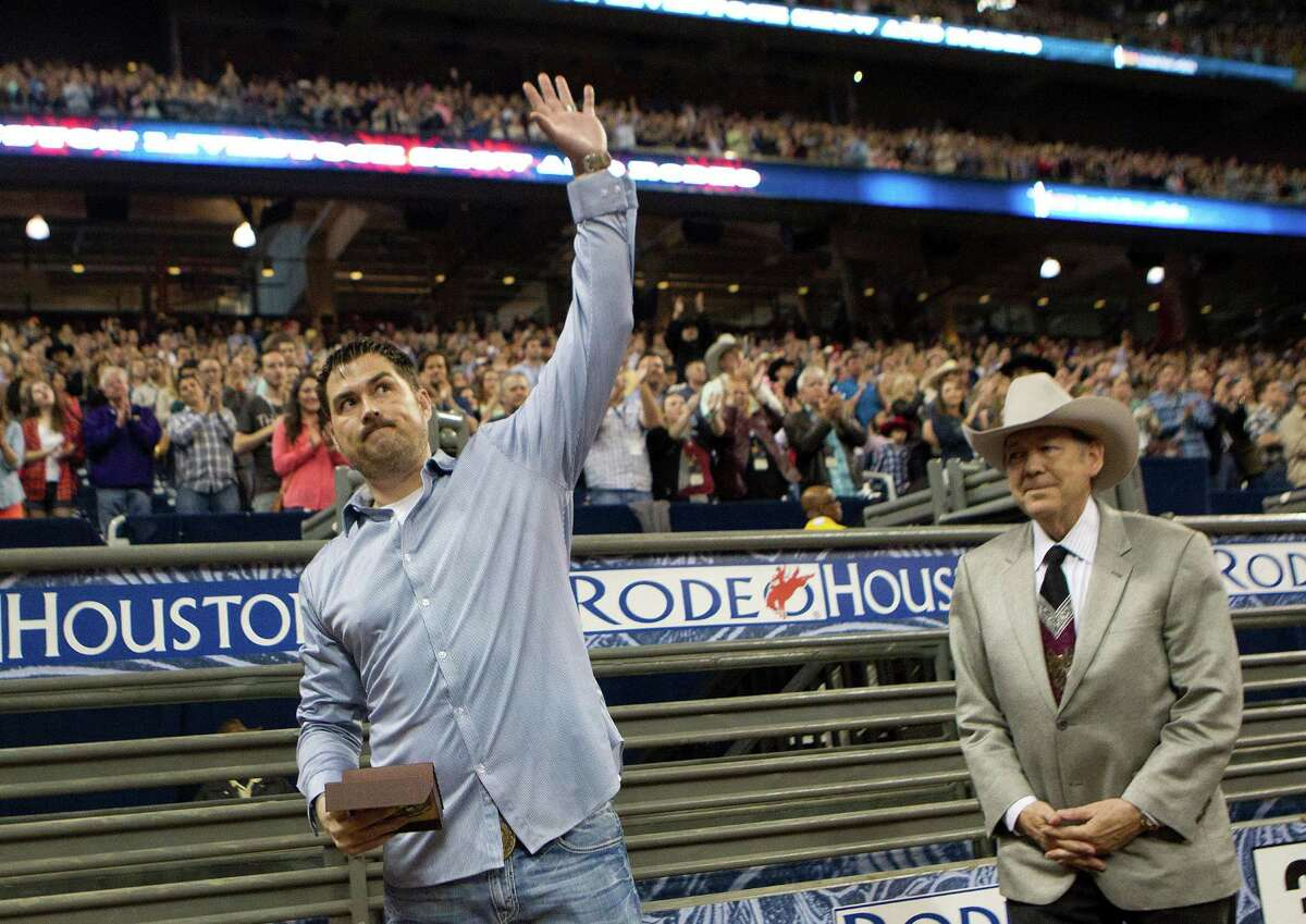 Marcus Luttrell, former United States Navy SEAL and author of the book Lone Survivor is introduced next to Leroy Shafer, Houston Livestock Show and Rodeo vice president and COO during RodeoHouston at Reliant Stadium Sunday, March 23, 2014, in Houston. Luttrell was given a belt buckle to honor him and what he did for the country.