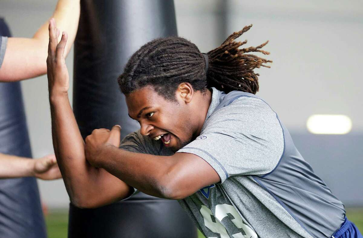 Benthune-Cookman linebacker Branden Bryant rushes past a tackling dummy Saturday, March 22, 2014, during position drills at an NFL football regional combine in Renton, Wash.