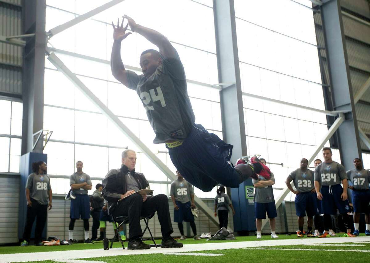 Jovon Mclaughlin jumps Saturday, March 22, 2014, during practice drills at an NFL football regional combine in Renton, Wash.