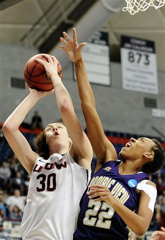 Connecticut's Breanna Stewart  shoots as Prairie View A&M's Larissa Scott defends during the  second half of a first-round game of the NCAA women's college basketball  tournament, Sunday, March 23, 2014, in Storrs, Conn. (AP Photo/Jessica  Hill)