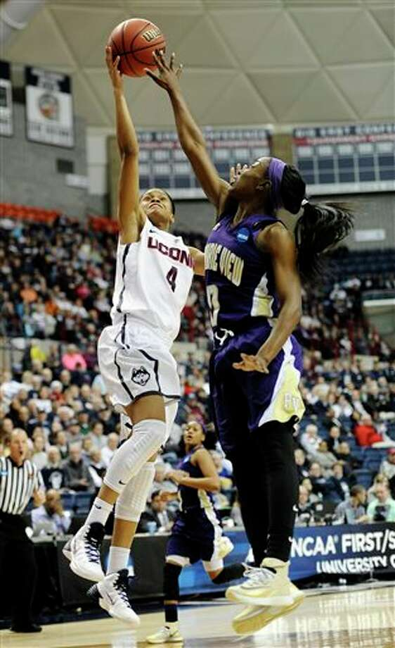 Connecticut's Moriah  Jefferson shoots as Prairie View A&M's LaReahn Washington defends  during the first half of a first-round game of the NCAA women's college  basketball tournament, Sunday, March 23, 2014, in Storrs, Conn. (AP  Photo/Jessica Hill)