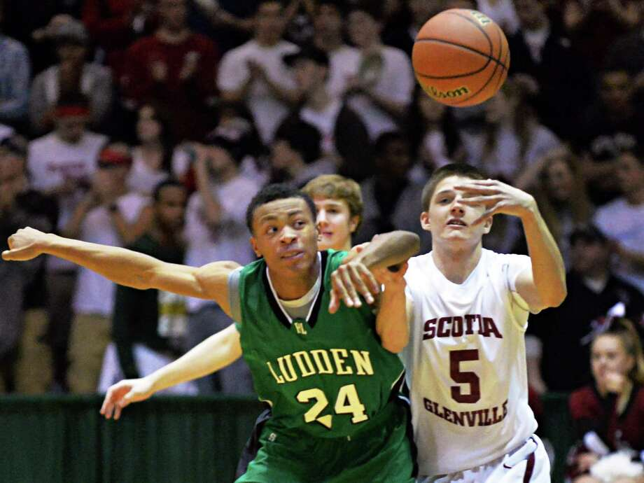 Bishop Ludden's #24 Cameron Beauford, left, steals the ball from Scotia's #5 Schuyler Stopera during the Class A boys' regional final Saturday March 8, 2014, in Troy, NY.  (John Carl D'Annibale / Times Union) Photo: John Carl D'Annibale / 00026032A
