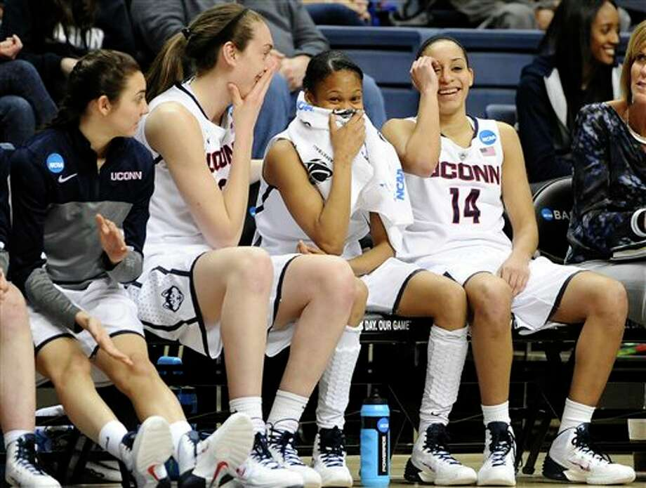 Connecticut's Briana Pulido,  left, Breanna Stewart, second from left, Moriah Jefferson, second from  right, and Bria Hartley, right, react as head coach Geno Auriemma curses  at an official during the second half of a first-round game of the NCAA  women's college basketball tournament, Sunday, March 23, 2014, in  Storrs, Conn.  Connecticut won 87-44. (AP Photo/Jessica Hill)