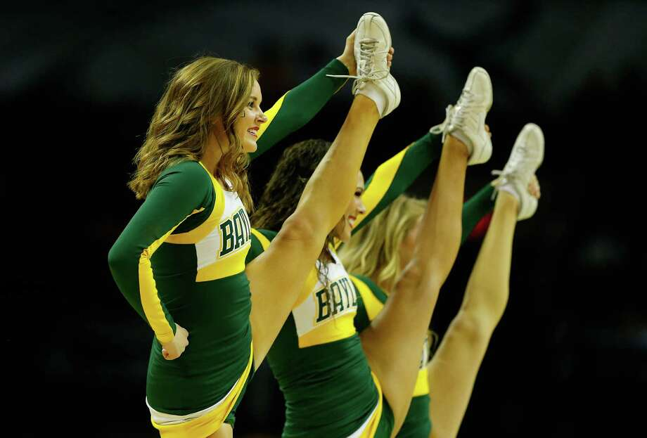 SAN ANTONIO, TX - MARCH 23:  Baylor Bears cheerleaders perform during the third round of the 2014 NCAA Men's Basketball Tournament against the Creighton Bluejays at the AT&T Center on March 23, 2014 in San Antonio, Texas. Photo: Tom Pennington, Getty Images / 2014 Getty Images