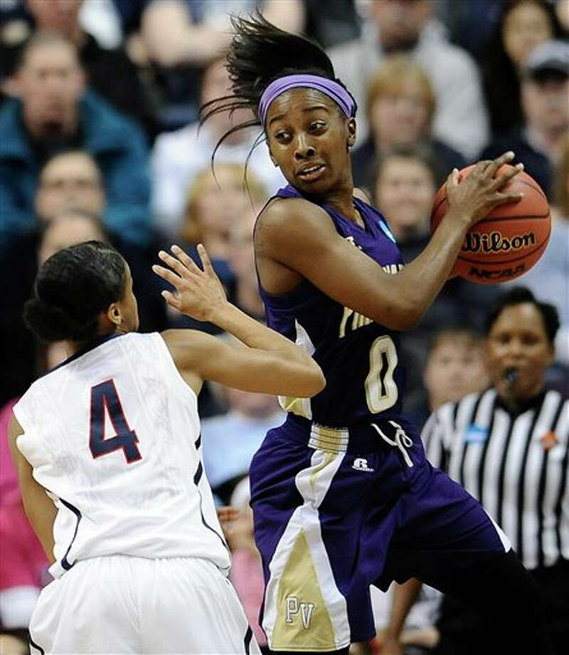 Connecticut's Moriah  Jefferson, left, pressures Prairie View A&M's LaReahn Washington,  right, during the first half of a first-round game of the NCAA women's  college basketball tournament, Sunday, March 23, 2014, in Storrs, Conn.  (AP Photo/Jessica Hill)