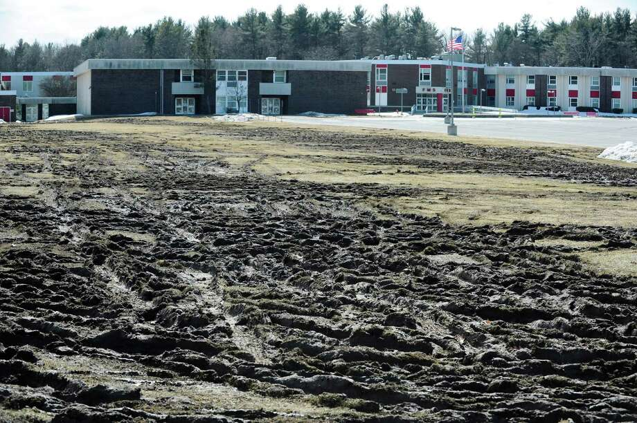 Athletic fields at  Farnsworth Middle School show damage on Sunday, March 23, 2014 at the school in Guilderland, NY.  People showing up to take a state civil service exam on Saturday parked on the grass, destroying the fields.  (Paul Buckowski / Times Union) Photo: Paul Buckowski