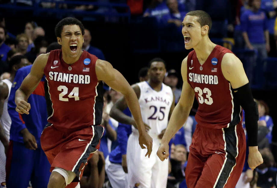 Stanford's Josh Huestis, left, and Dwight Powell, right, celebrate as Kansas' Tarik Black (25) watches in the background after in a third-round game of the NCAA college basketball tournament Sunday, March 23, 2014, in St. Louis. Stanford won 60-57. (AP Photo/Jeff Roberson)  ORG XMIT: MOJR118 Photo: Jeff Roberson / AP
