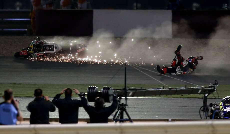 German MotoGP rider Stefan Bradl of the LCR Honda MotoGP team falls off his bike, during a final session of the Moto GP World Championship, at the Losail International Circuit in Doha, Qatar, Sunday, March 23, 2014. (AP Photo/Osama Faisal) Photo: Osama Faisal, Associated Press