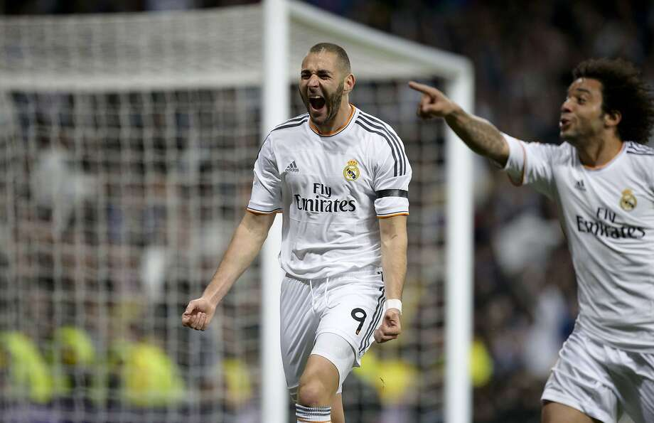 "Real Madrid's French forward Karim Benzema celebrates after scoring during the Spanish league ""Clasico"" football match Real Madrid CF vs FC Barcelona at the Santiago Bernabeu stadium in Madrid on March 23, 2014.   TOPSHOTS/AFP PHOTO/DANI POZODANI POZO/AFP/Getty Images Photo: Dani Pozo, AFP/Getty Images"