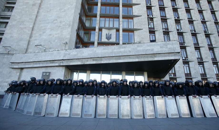 Ukrainian riot police block the entrance of the regional administrative building, during a pro Russian rally in Donetsk, eastern Ukraine, Sunday, March 23, 2014. About 5,000 people demonstrated in Donetsk in favor of holding a referendum on secession and absorption into Russia similar to Crimea's. (AP Photo/Sergei Grits) Photo: Sergei Grits, Associated Press