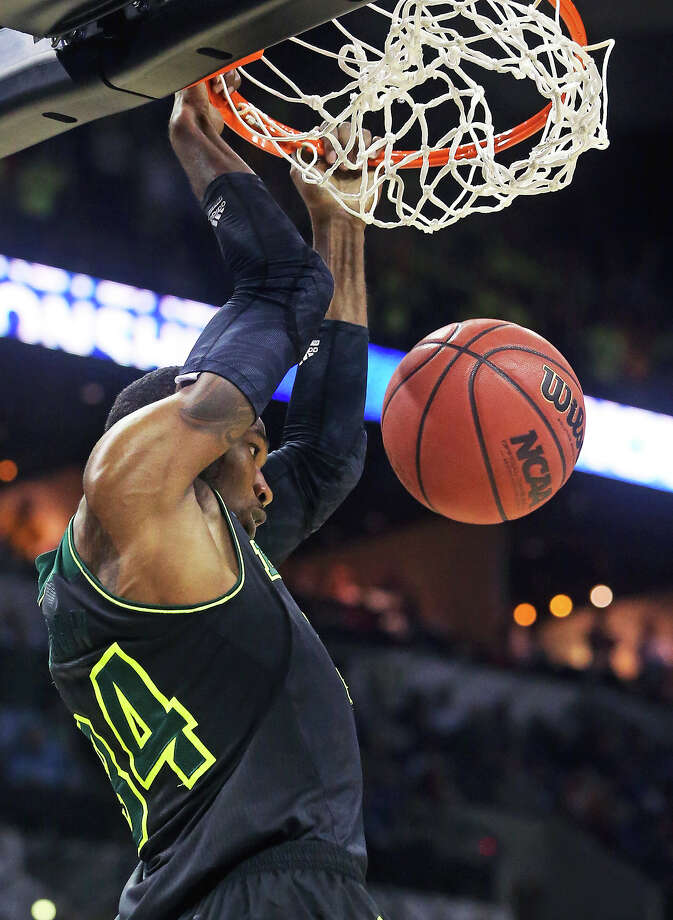 Bear forward Cory Jefferson jams down a pass to the rim as Baylor plays Creighton in the third round of the 2014 NCAA Divison I  Men's Basketball Championship tournament  at the AT&T Center on March 23, 2014. Photo: TOM REEL