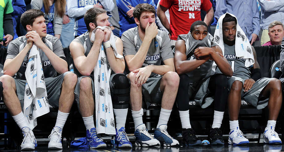 Members of the Creighton Bluejays sit dejected on the bench late in their third round 2014 NCAA Division I Men's Basketball Championship tournament game against Baylor held Sunday March 23, 2014 at the AT&T Center. Baylor won 85-55. Photo: Edward A. Ornelas, San Antonio Express-News / © 2014 San Antonio Express-News