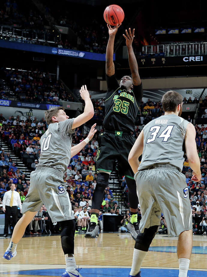 Baylor's Taurean Prince (35) shoots between Creighton's Grant Gibbs (10) and Creighton's Ethan Wragge (34) during first half action of their third round 2014 NCAA Division I Men's Basketball Championship tournament game held Sunday March 23, 2014 at the AT&T Center. Photo: Edward A. Ornelas, San Antonio Express-News / © 2014 San Antonio Express-News