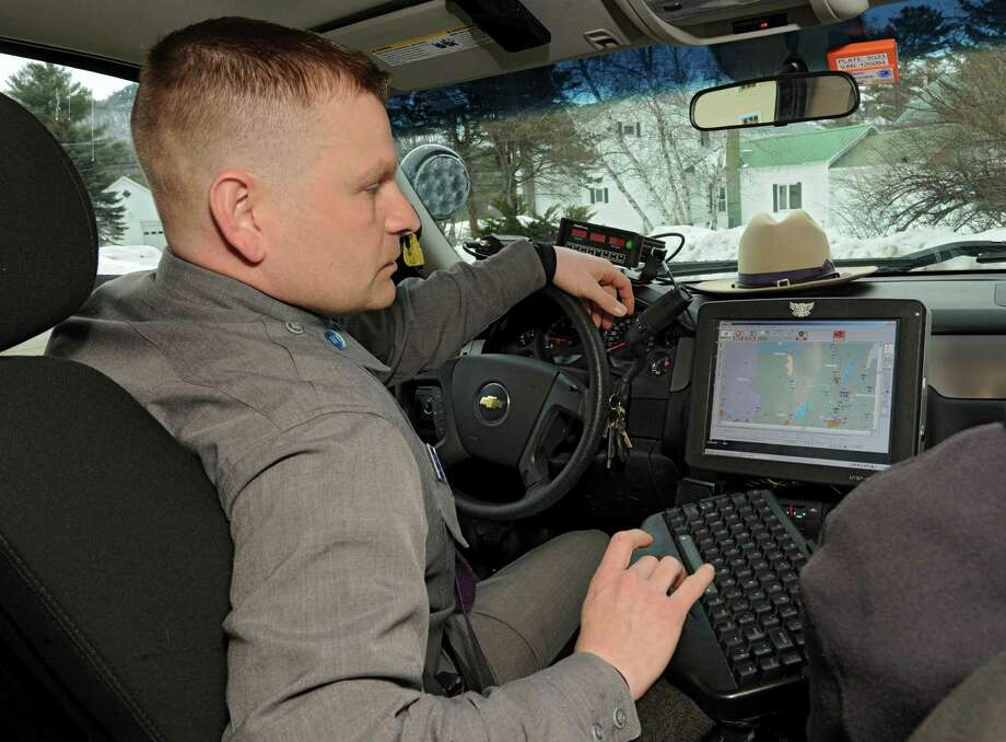 NY State Trooper Ronald Dacre turns on his computer before patrolling the roads on Wednesday, March 19, 2014 in Wells, N.Y.  State Police are now covering the town of Wells and its surrounding areas for the first time in more than 20 years. The area, in Hamilton County, is so desolate it is the only area in the east that is has been federally declared a frontier. (Lori Van Buren / Times Union) Photo: Lori Van Buren / 00026174A