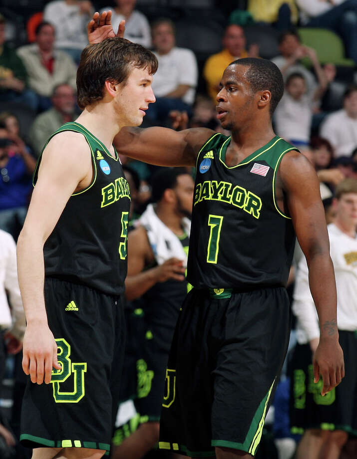 Baylor's Brady Heslip (05) is congratulated by teammate Baylor's Kenny Chery (01) after making a 3-pointer during second half action of their third round 2014 NCAA Division I Men's Basketball Championship tournament game against Creighton held Sunday March 23, 2014 at the AT&T Center. Baylor won 85-55. Photo: Edward A. Ornelas, San Antonio Express-News / © 2014 San Antonio Express-News