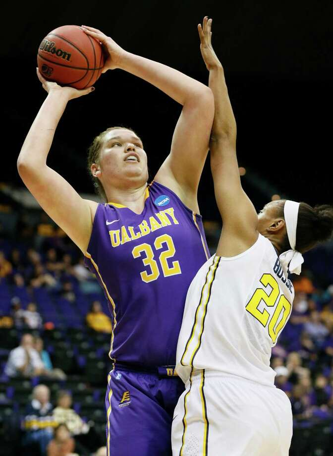 Albany center Megan Craig (32) attempts a shot at the basket while West Virginia center Asya Bussie (20) defends in the first half of an NCAA college basketball first-round tournament game on Sunday, March 23, 2014, in Baton Rouge, La. (AP Photo/Rogelio V. Solis) ORG XMIT: LARS114 Photo: Rogelio V. Solis / AP