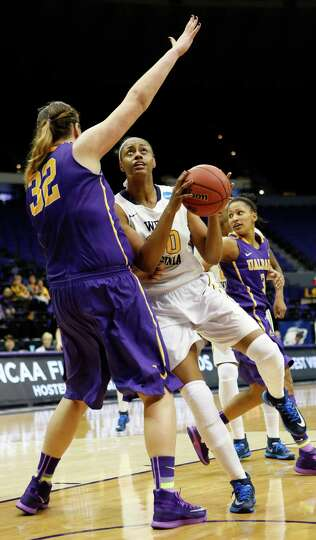 West Virginia center Asya Bussie (20) tries to lean into Albany center Megan Craig (32) in the secon