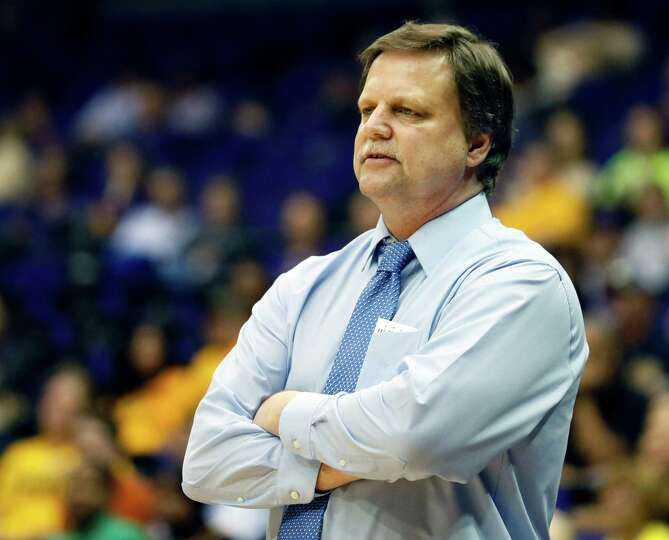 West Virginia basketball coach Mike Carey calls out to his team in the second half of an NCAA colleg