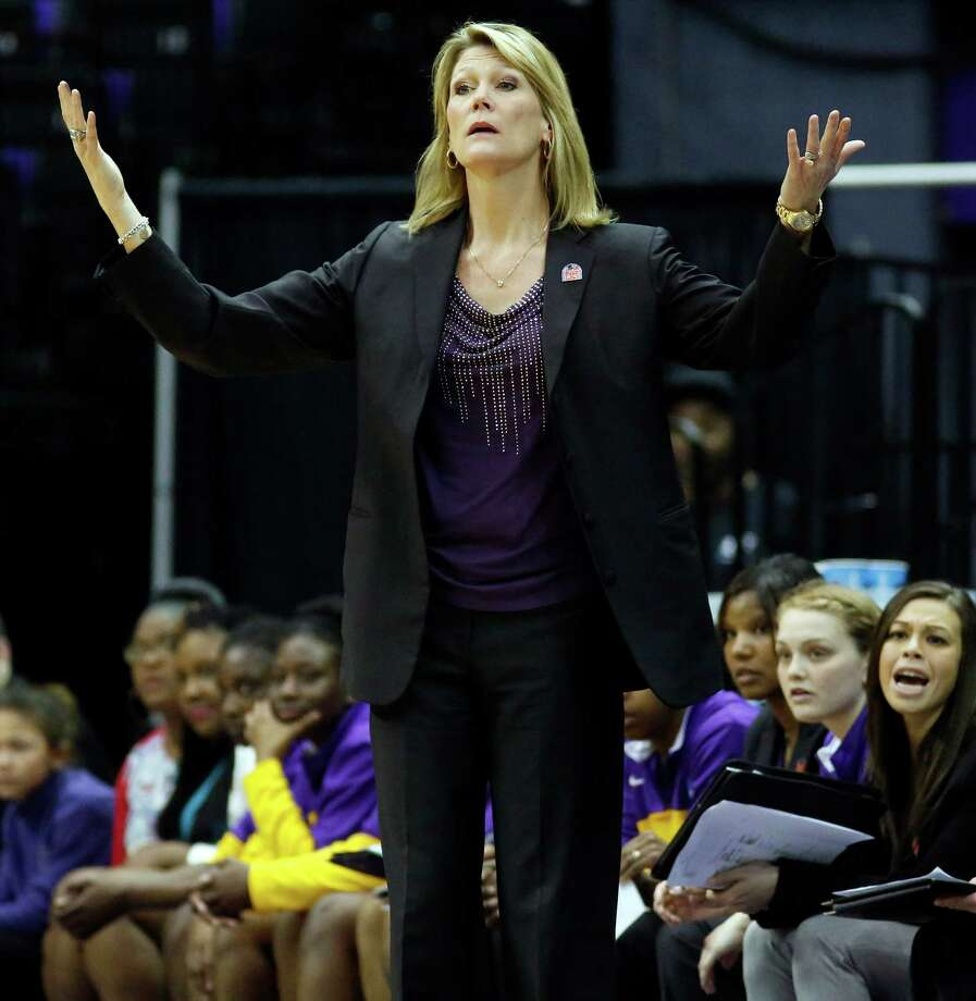 Albany basketball coach Katie Abrahamson-Henderson reacts to her team's play against West Virginia in the second half of an NCAA college basketball first-round tournament game on Sunday, March 23, 2014, in Baton Rouge, La. West Virginia won 76-61. (AP Photo/Rogelio V. Solis) ORG XMIT: LARS127 Photo: Rogelio V. Solis / AP