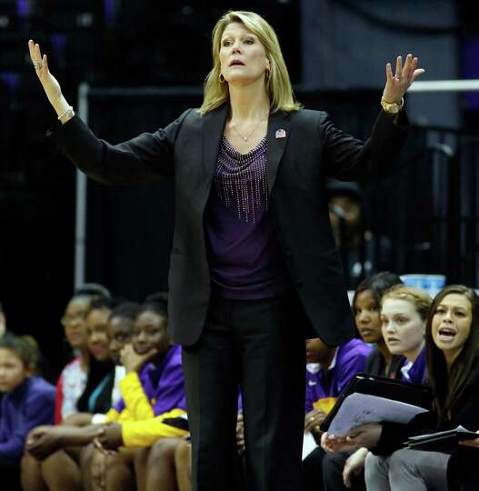 Albany basketball coach Katie Abrahamson-Henderson reacts to her team's play against West Virginia i