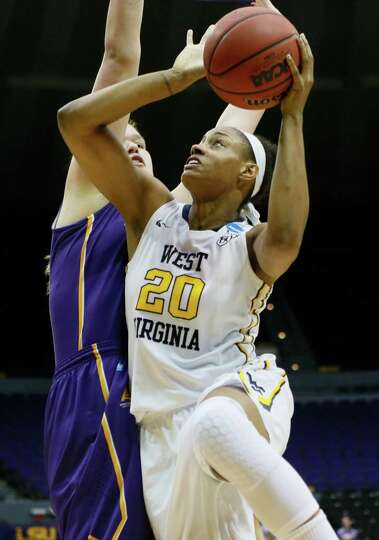 West Virginia center Asya Bussie (20) attempts to shoot while Albany center Megan Craig defends in t
