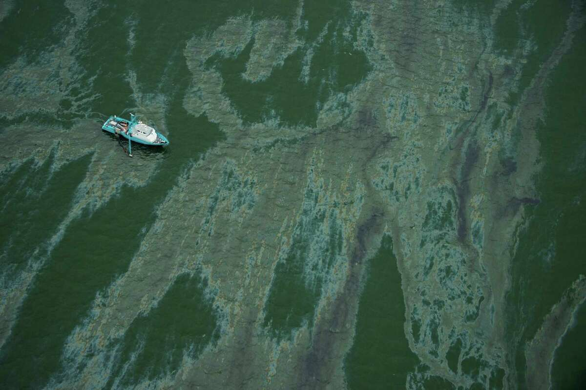 A vessel near the Port of Galveston is surrounded Sunday by heavy marine fuel oil, known to defy traditional chemical dispersants.