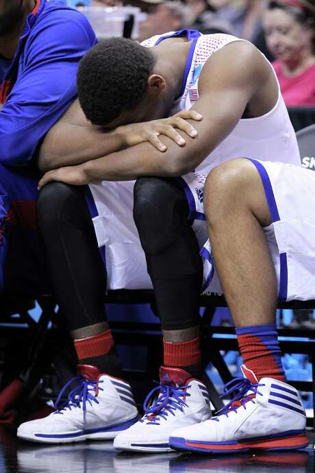 Wayne Selden refuses to watch as the end of Kansas' season unfolds. Photo: Andy Lyons, Staff / 2014 Getty Images