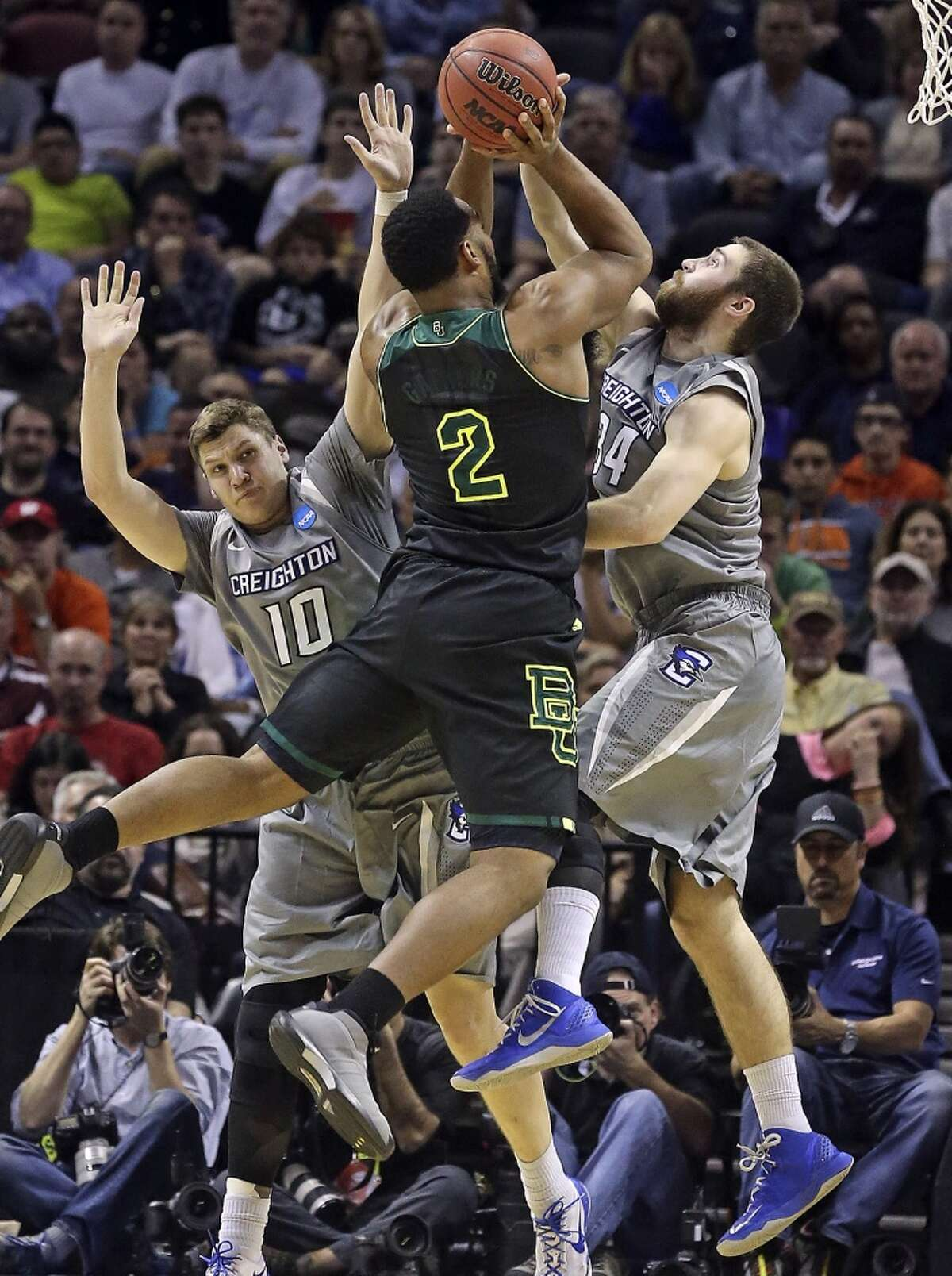 Bear forward Rico Gathers flies in for a shot against the off balance defense of Grant Gibbs (10) and Ethan Wragge as Baylor plays Creighton in the third round of the 2014 NCAA Divison I Men's Basketball Championship tournament at the AT&T Center on March 23, 2014.