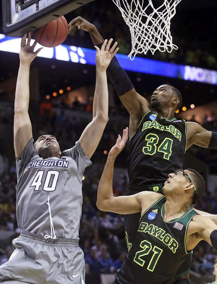 Bear forward Cory Jefferson blocks Zach Hanson's attempt at the hoop as Bear center Isaiah Austin comes in to help as Baylor plays Creighton in the third round of the 2014 NCAA Divison I  Men's Basketball Championship tournament  at the AT&T Center on March 23, 2014. Photo: Tom Reel, San Antonio Express-News