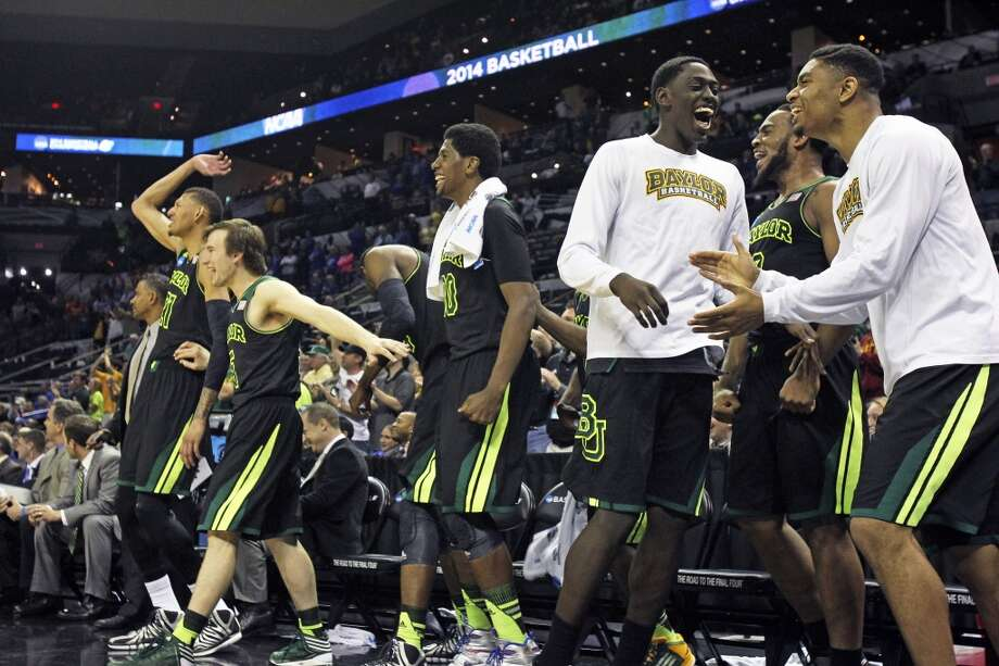 The Bears celebrate voctory as Baylor beats Creighton 85-55 in the third round of the 2014 NCAA Divison I  Men's Basketball Championship tournament  at the AT&T Center on March 23, 2014. Photo: Tom Reel, San Antonio Express-News