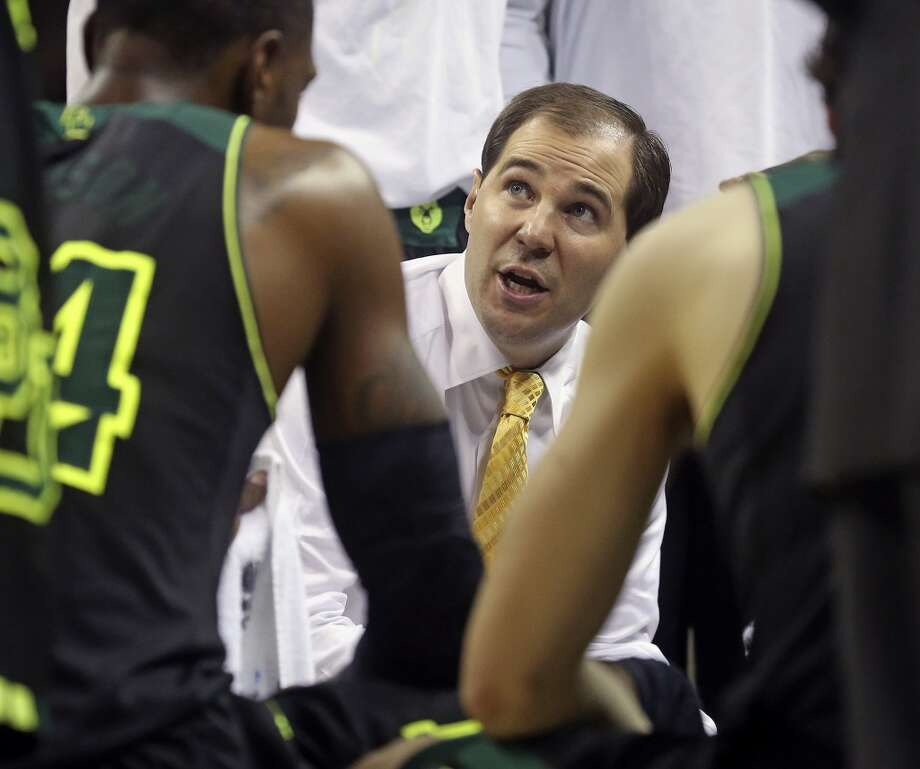 Bear coach Scott Drew talks with his players in the huddle as Baylor plays Creighton in the third round of the 2014 NCAA Divison I  Men's Basketball Championship tournament  at the AT&T Center on March 23, 2014. Photo: Tom Reel, San Antonio Express-News