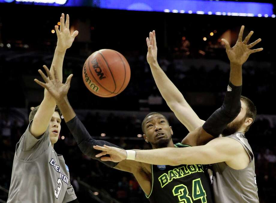 Baylor's Cory Jefferson (34) loses the ball as Creighton's Ethan Wragge, right, and Doug McDermott (3) defend during the second half of a third-round game in the NCAA college basketball tournament Sunday, March 23, 2014, in San Antonio. Baylor won 85-55. (AP Photo/David J. Phillip)  ORG XMIT: TXDP126 Photo: David J. Phillip / AP
