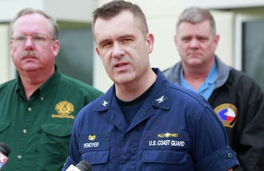 U.S. Coast Guard Capt. Brian Penoyer, center, speaks about oil spill during media conference Sunday, March 23, 2014, in Texas City. Photo: Melissa Phillip, Houston Chronicle / © 2014  Houston Chronicle