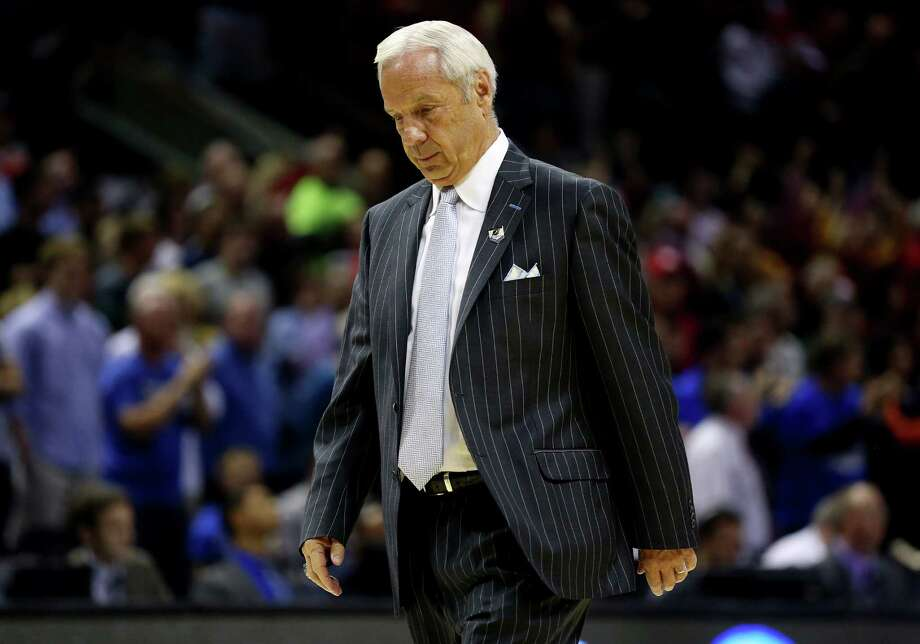 SAN ANTONIO, TX - MARCH 23: Head coach Roy Williams of the North Carolina Tar Heels walks off the court after losing to the Iowa State Cyclones 85-83 during the third round of the 2014 NCAA Men's Basketball Tournament at the AT&T Center on March 23, 2014 in San Antonio, Texas.  (Photo by Ronald Martinez/Getty Images) ORG XMIT: 459542685 Photo: Ronald Martinez / 2014 Getty Images