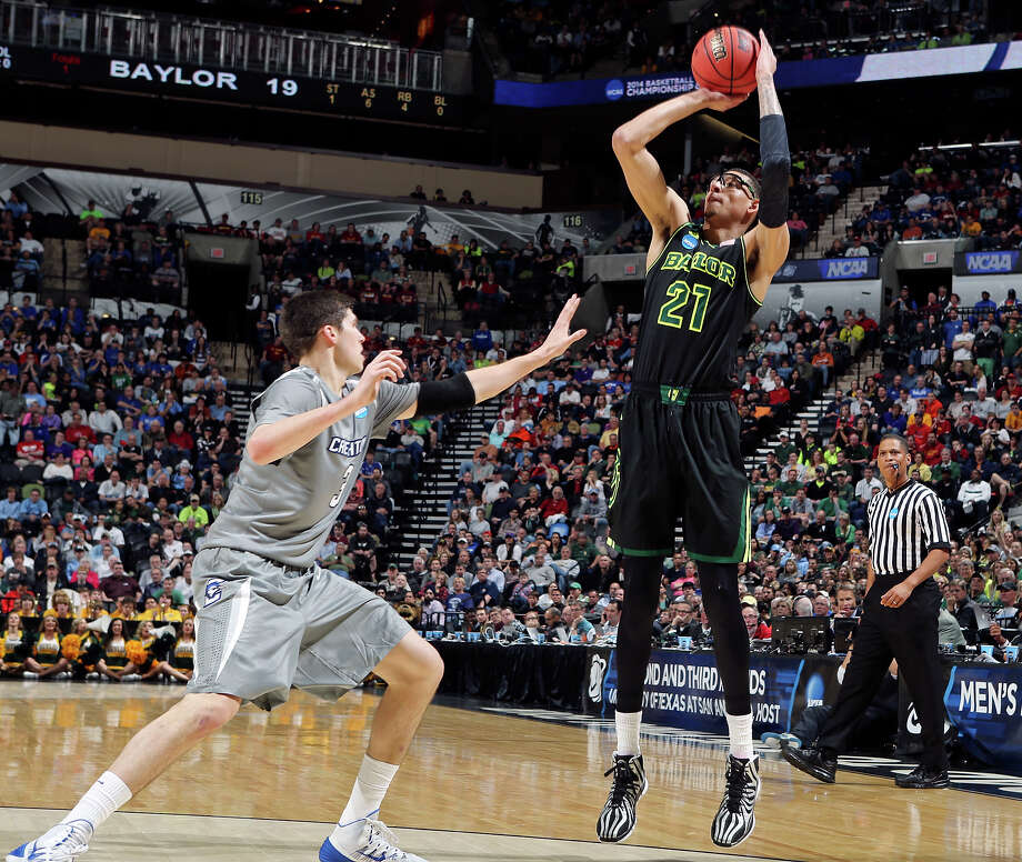 Baylor's Isaiah Austin (21) shoots over Creighton's Doug McDermott (03) during first half action of their third round 2014 NCAA Division I Men's Basketball Championship tournament game held Sunday March 23, 2014 at the AT&T Center. Photo: Edward A. Ornelas, San Antonio Express-News / © 2014 San Antonio Express-News