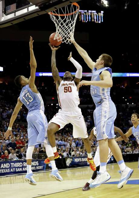 Iowa State's DeAndre Kane (50) slices through the North Carolina defense for the game-winning basket. Photo: David J. Phillip, STF / AP