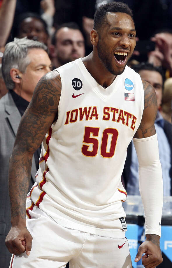 DeAndre Kane celebrates Iowa State's win. His layup with less than two seconds left sent the Cyclones to a meeting with Connecticut. / © 2014 San Antonio Express-News