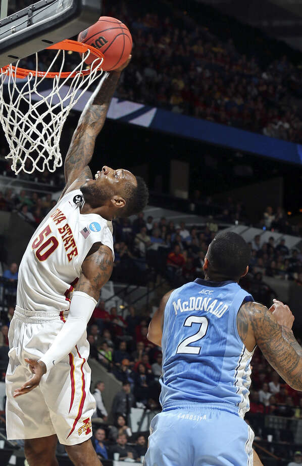 Iowa State's DeAndre Kane dunks around North Carolina's Leslie McDonald. Kane finished with 24 points, 10 rebounds and seven assists in 39 minutes. Photo: Tom Reel / San Antonio Express-News / © 2014 San Antonio Express-News