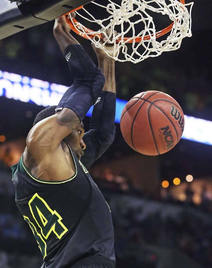 Baylor forward Cory Jefferson dunks for two of his 14 points during the Bears' 85-55 thrashing of Creighton during the third round at the AT&T Center. The Bears will face Wisconsin on Thursday in the Sweet 16. Photo: Tom Reel / San Antonio Express-News