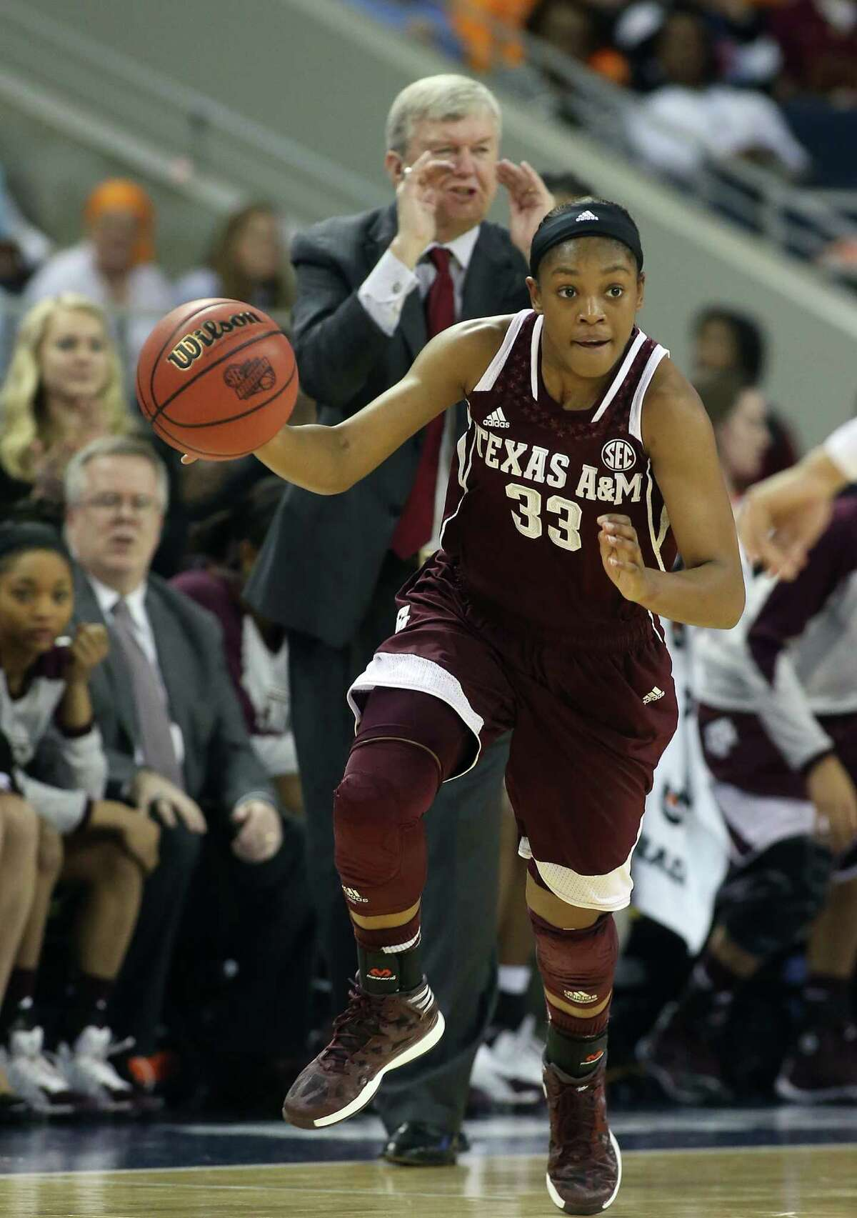 Texas A&M guard Courtney Walker (33) is shown against Tennessee in the first half of an NCAA college basketball game in the semifinals of the Southeastern Conference women's basketball tournament Saturday, March 8, 2014, in Duluth, Ga. (AP Photo/Jason Getz)