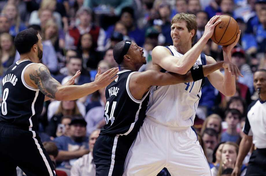 Paul Pierce (34) and the Nets harassed Dirk Nowitzki into a 2-for-12 shooting night. Photo: LM Otero, STF / AP