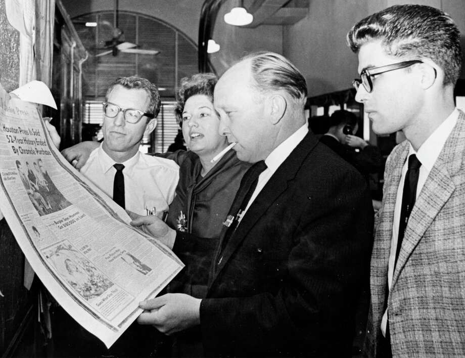 Houston Press writers, photographers read paper's swan song: From left, Arlo Wagner, Marge Crumbaker, Bill Cooksey, Frank Grizzaffi, March 20, 1964. After the Press closed, Crumbaker would embark on a long career with the Houston Post. Photo: Houston Chronicle / Houston Chronicle