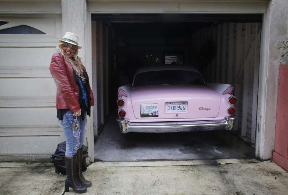 Siobhan Neilland prepares to take her beloved pink 58 Dodge coronet for a joy ride around San Francisco. She has had the car since she was 17 and has never owned a new car.  The two have been inseparable for the past 29 years. Photo: Mike Kepka, The Chronicle