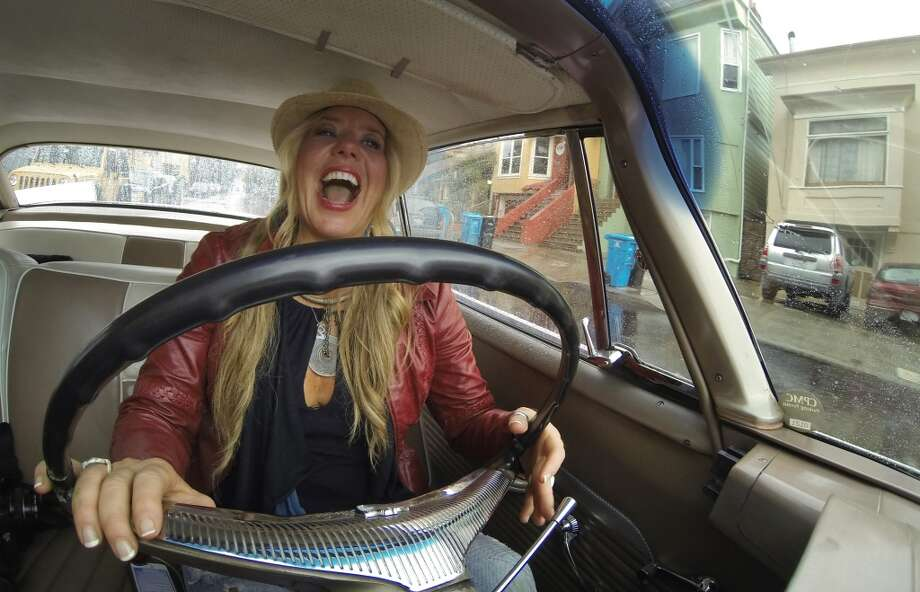 Siobhan Neilland smiles as she drives her 58 Dodge coronet around San Francisco. Photo: Mike Kepka , The Chronicle